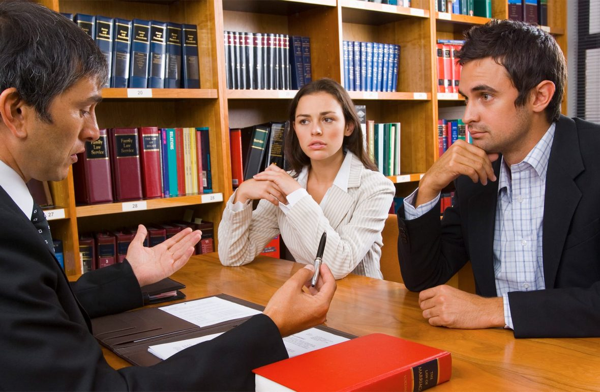 Lawyer Discussing with Couple for Divorce